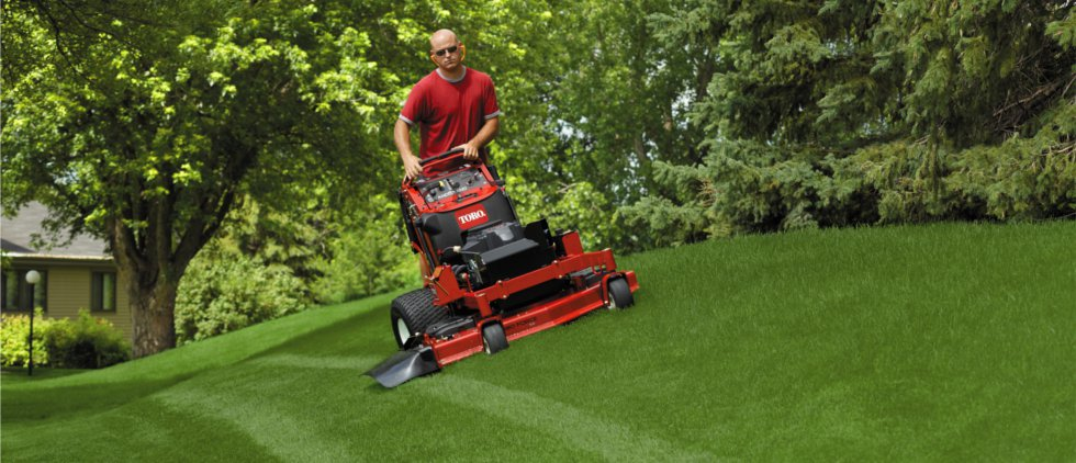 Man Mowing Lawn with Toro